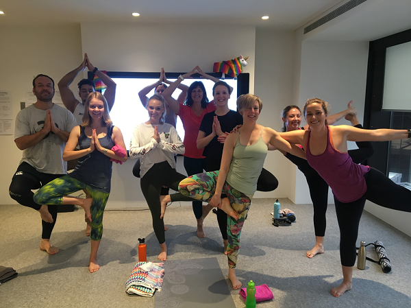 Amy and her Accenture colleagues practising yoga at work