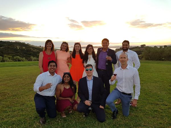 Amy and her Accenture colleagues sampling New Zealand wine together