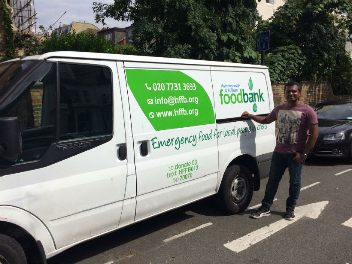 Ramesh using his paid charity days to help with a foodbank project