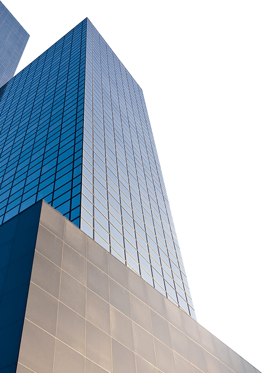 Back view of blue mirrored building that is standing in a big block