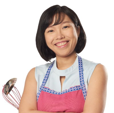 Dellytania wearing an apron while holding a cooking utensils