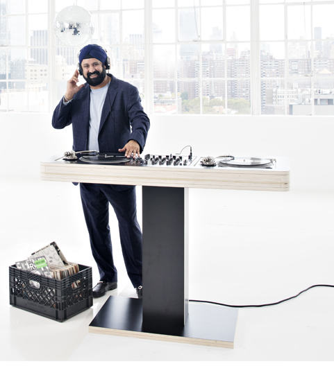 Man in a formal attire acting as a disc jockey