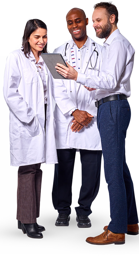 Front view of the three doctors watching in the tablet with a smile