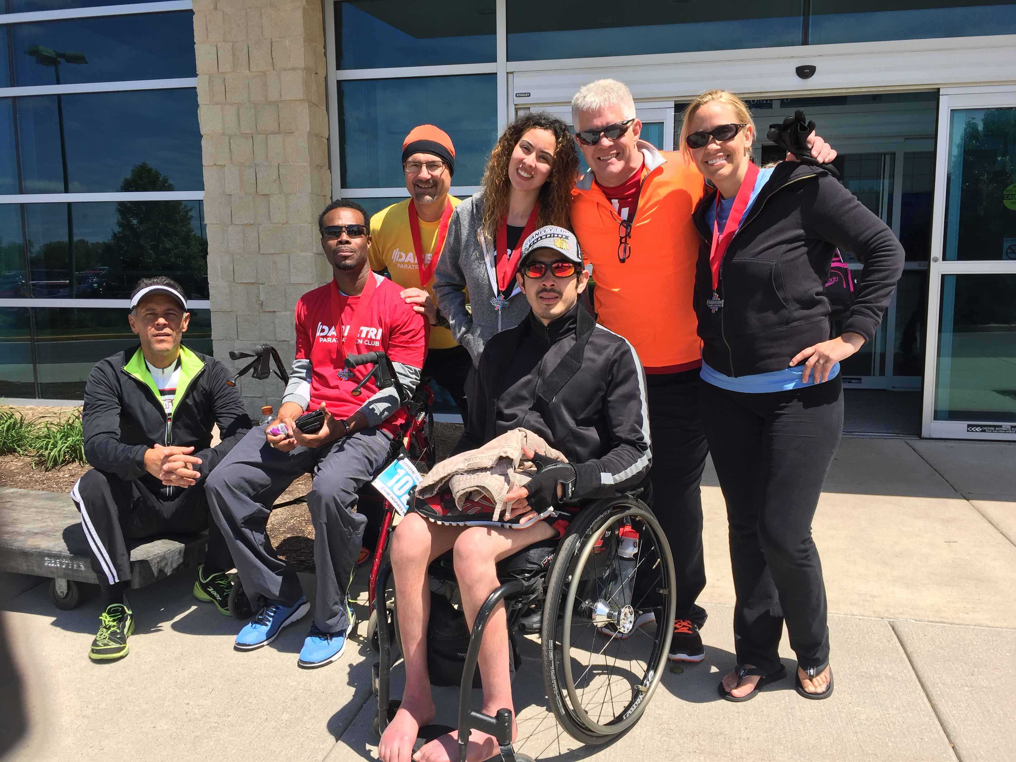 Chad Jerdee, general counsel and chief compliance officer at Accenture, standing second from right, with a group of triathlon participants.