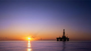 Can technology help upstream energy companies hedge against low oil prices?