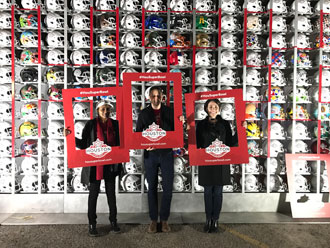 Our volunteer's #HoustonLIVE photo opp in front of the wall of helmets!