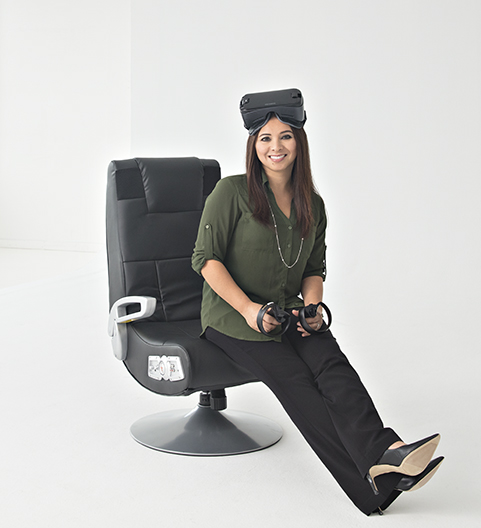 Lady wearing a VR headset while sitting on a swivel chair